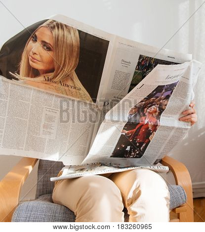 PARIS FRANCE - APR 24 2017: Marine Le pen on newspaper article of Die Zeit - woman reading t newspaper a day after the first round of the French Presidential election on April 24 2017
