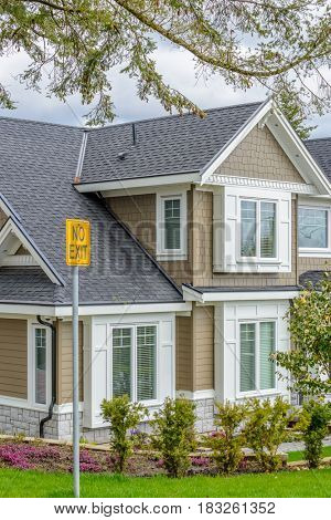 A perfect neighborhood. Houses in suburb at Spring in the north America. Fragment of a luxury house with nice window.