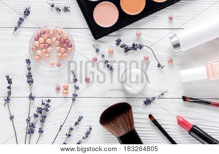make up set with decorative cosmetics for beauty design on white woman desk background top view