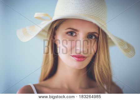 Portrait of beautiful model in hat , isolated on white background.