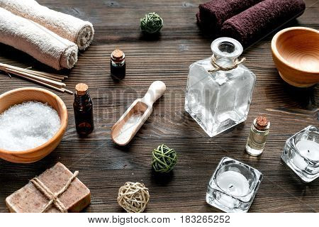 spa set with towels and organic soap on wooden table background