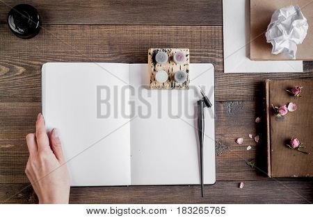 writer tools with hands in profession concept on wooden desk background top view