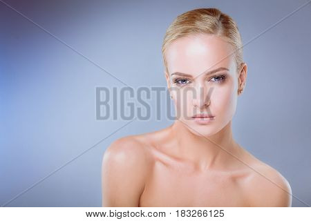 Portrait of a beautiful woman , isolated on gray background.