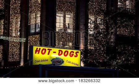 Neon hot dog sign in the city of amsterdam