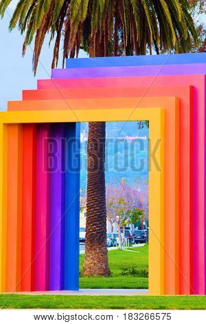 Colorful metal abstract style Chromatic Gate Rainbow Arch which is a landmark sculpture at the beach taken in Santa Barbara, CA