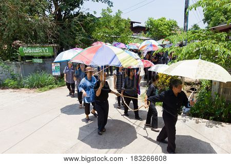 CHIANG RAI THAILAND - APRIL 19 : unidentified asian Protestant Christian people walking to the graveyard on April 19 2017 in Chiang rai Thailand.
