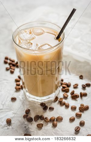 black coffee ice cubes and beans with latte for lunch on stone desk background