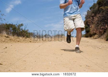 Man Jogging On Mountain Trail