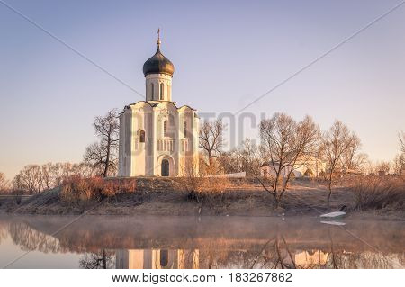 The Mist-shrouded Lake In Front Of The Ancient Church, A Frosty Morning