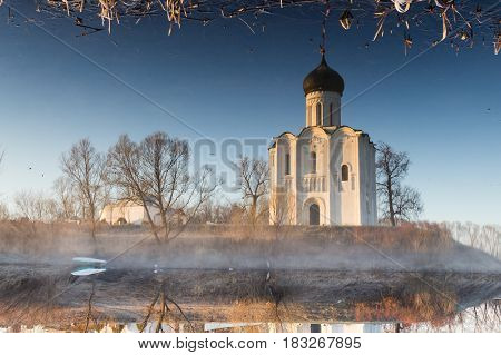 Magic Reflection Of A Beautiful, Ancient Church In A Pond, A Frosty Morning