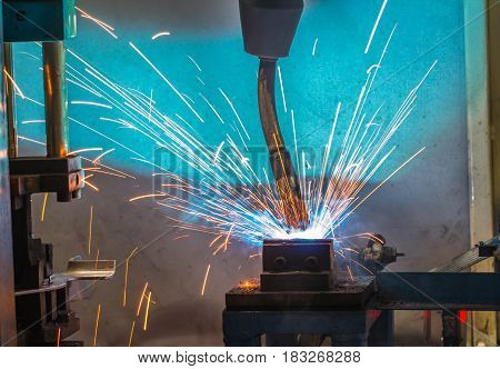 Welding robots movement in a car production factory
