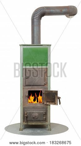 Old masonry heater oven with burning wood fire