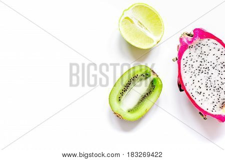Tropical fresh fruit design on white table background top view space for text
