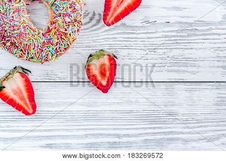 coloful donut with topping flat lay on wooden background top view mock up