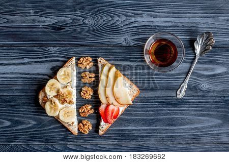 fitness breskfast with homemade sandwiches on dark table background top view