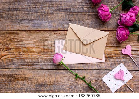 pink peony and greeting-card for present design on wooden table background top view mockup