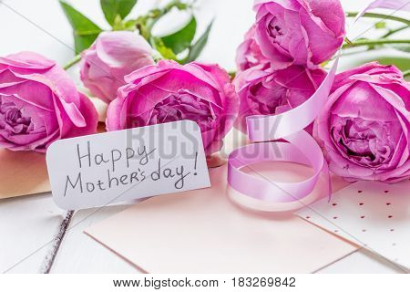 pink peony and greeting-card for Mother's day present design on wooden table background