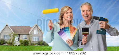 Elderly couple with renovation tools