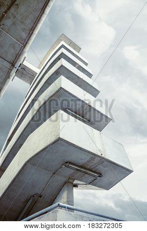 modern architecture outdoor stairs under  bridge shot from below
