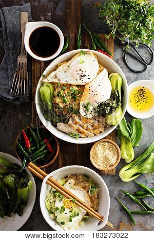 Asian food concept with fried rice, baby bok choy, eggs and soy sauce