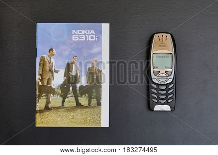 BUDAPEST, HUNGARY - APRIL 24, 2017: Nokia 6310i cellphone with its original user manual. The 6310i was a very popular corporate phone after its 2002 introduction