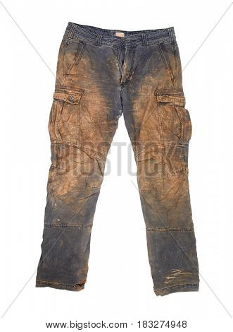 Torn and dirty working trousers covered in mud and clay