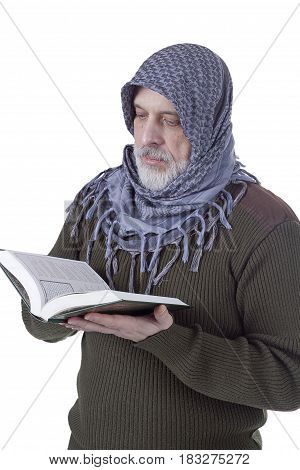 Muslim man with a Quran in hands on a white background