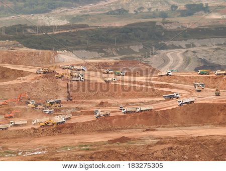 many mining truck use for move soil before to use heavy machine to come to find some lignite December 07 2010 Lampang Thailand.