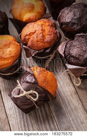 Chocolate muffins on a wooden table