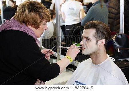 Kyiv, Ukraine - February 8, 2017: Makeup Artist At Work. Backstage Of Ukrainian Fashion Week 2017