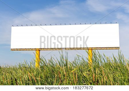 The grand blank billboard ready for new advertisement with blue sky background