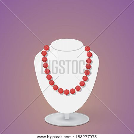 red beads on a light gray exhibition bust