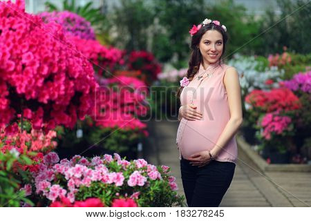 cute pregnant woman relaxing in park