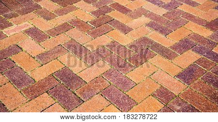 Old Italian brick cotto floor with z pattern.