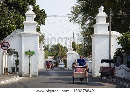 Yogyakarta, Indonesia - september 15, 2015: Traditional street scene with cyclo driver in Yogyakarta, Indonesia