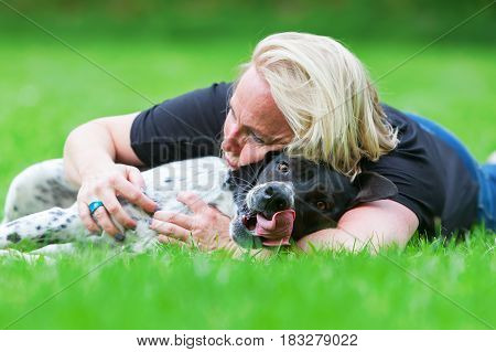 Portrait Of A Woman Hugging Her Dog