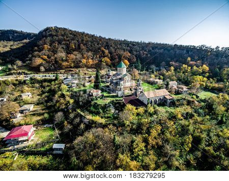 Scenic view of Gelati monastery on bright summer day, Georgia, aerial