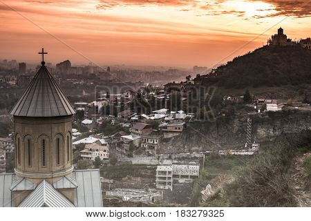 beautiful sunset view of Tbilisi and Saint Nicholas Church from Narikala Fortress, Georgia