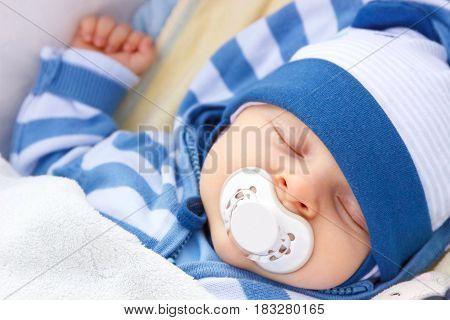 Newborn Baby With Pacifier Sleeping In Baby Pram