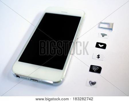 A White Smart Phone, Sim Card Tray And Small Paper Simulated As A Sim Card On White Background