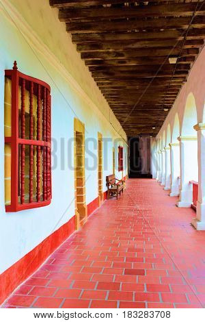 April 10, 2017 in Santa Barbara, CA:  Hallway at the Santa Barbara Mission founded in 1786 where tourists can experience a historical Spanish style building which is a historical landmark taken in Santa Barbara, CA