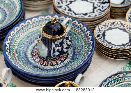 Ethnic Uzbek ceramic tableware. Decorative ceramic plate