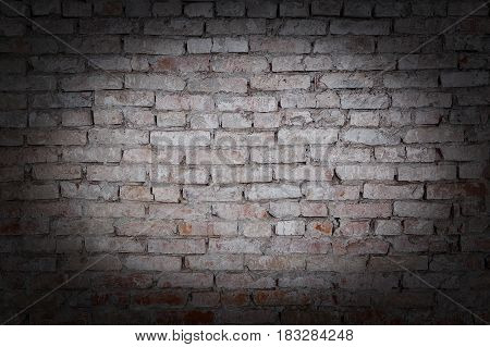 old rick wall texture grunge background with vignetted corners.
