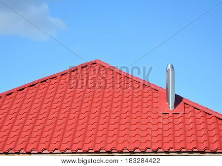 Metal roof construction. Metal Tile Roofing. Roofing Construction with steel chimney.