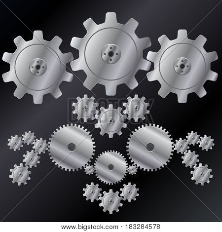 Steel gears represented on a contrast dark background.