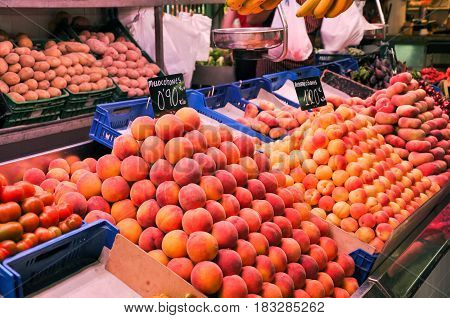 Grocery Market In Barcelona, Spain. Fresh Raw Ripe Fruits And Vegeables. Apricots Peaches, Nectarine