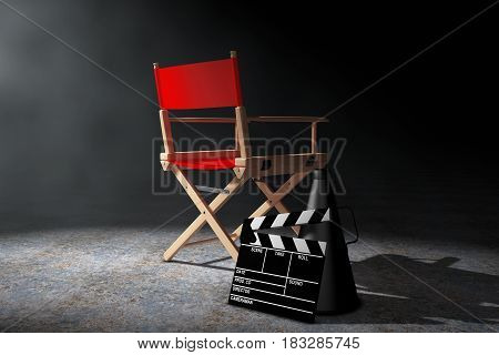 Cinema Industry Concept. Red Director Chair Movie Clapper and Megaphone in the volumetric light on a black background. 3d Rendering.