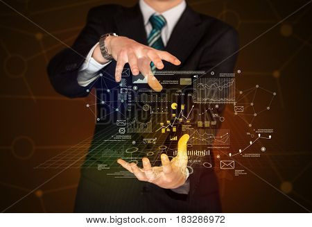 Businessman with strategy and planification related drawings between his hands