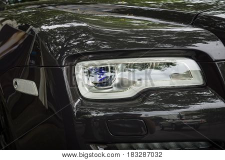 BERLIN - JUNE 14 2015: Fragment of the full-size luxury car Rolls-Royce Ghost (since 2010). The Classic Days on Kurfuerstendamm.