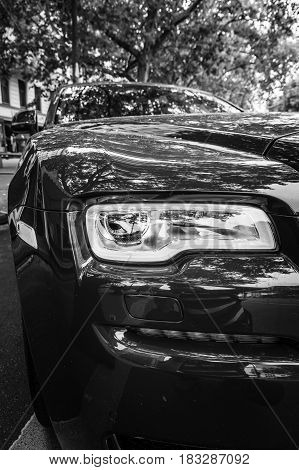 BERLIN - JUNE 14 2015: Fragment of the full-size luxury car Rolls-Royce Ghost (since 2010). Black and white. The Classic Days on Kurfuerstendamm.